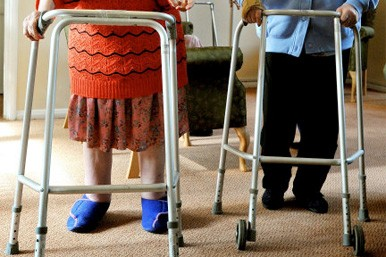old couple with zimmer frames