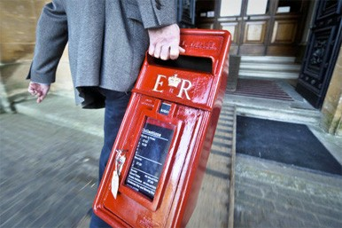 post box being carried away