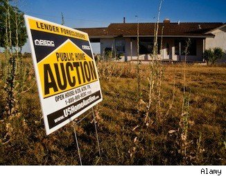 Home auctions: A home auction sign advertises a foreclosure.