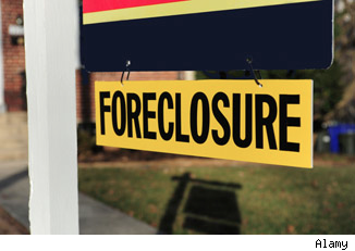Foreclosure sign: 10 worst cities to buy them