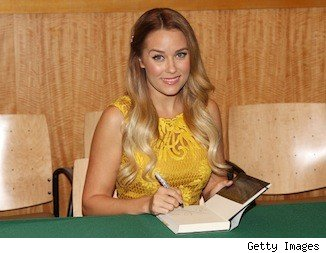Lauren Conrad autographs a book