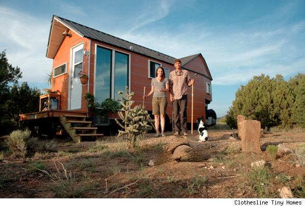 Carrie, Shane Caverly in front of their tiny home