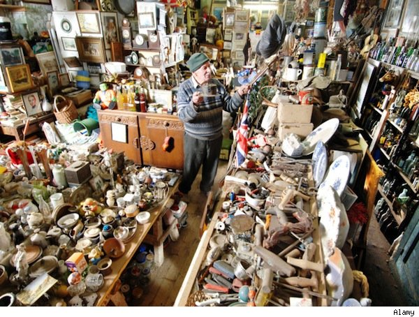 male hoarder amid clutter