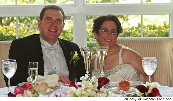 Paul Forziano, Hava Samuels seated at their wedding