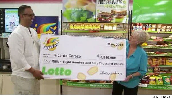 Ricardo Cerezo of Geneva, Ill., with lottery ticket that saved him from foreclosure