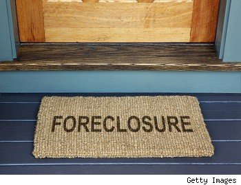 foreclosure on doormat of photo illustration