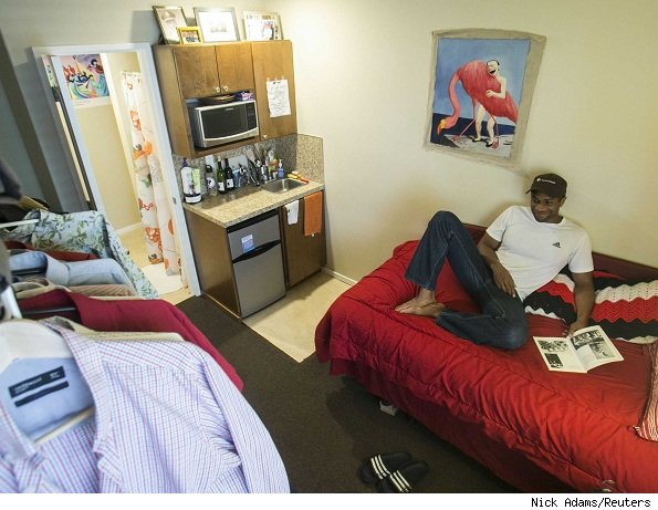Inside his Seattle micro apartment, Jon-Christian Stubblefield relaxes on the bed.