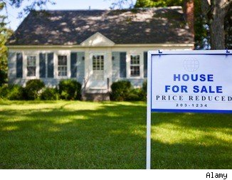 house for sale sign in front yard