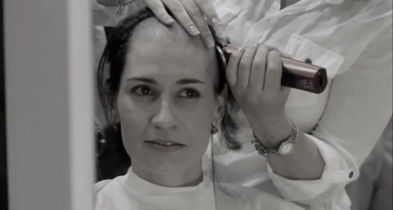Woman head shaving