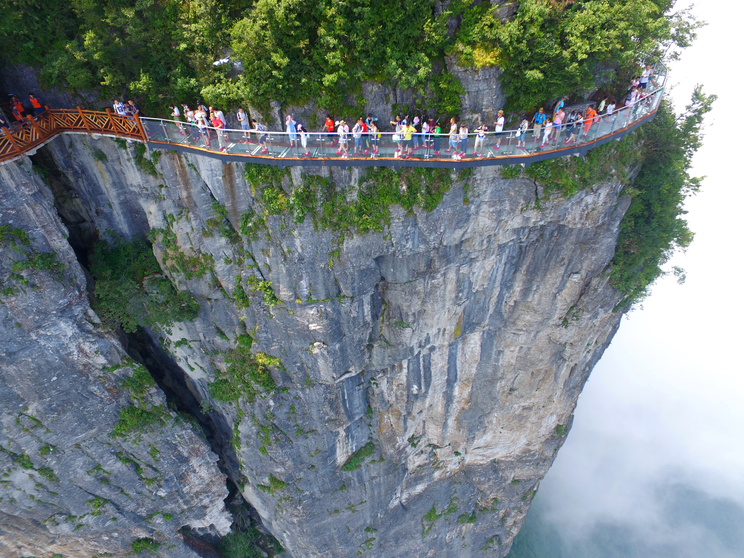China's terrifying new glass walkway suspends tourists over a 1500 foot gorge