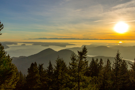 Sunset Orcas Island pacific northwest.  Mountain trees and the puget sound sea ocean