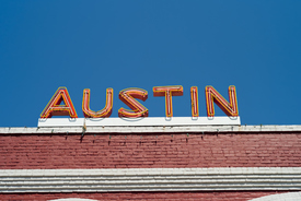 'An orange neon sign for Austin sits atop an old red brick building in downtown Austin, Texas.  Shot with a Leica M8.Check out my other images of Austin, Texas:'