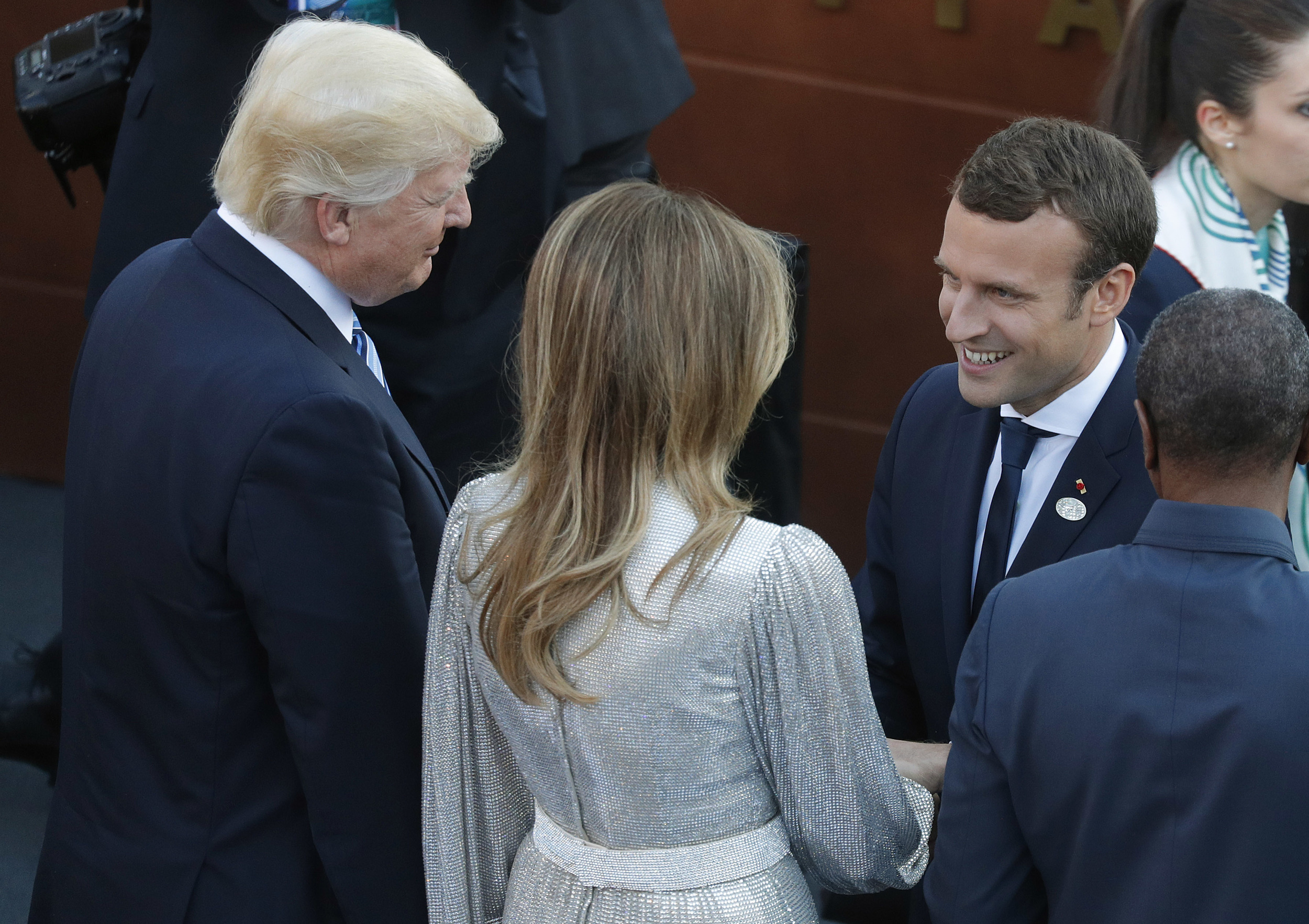 Trump, arriving in Paris, lashes out at Macron over defense remarks