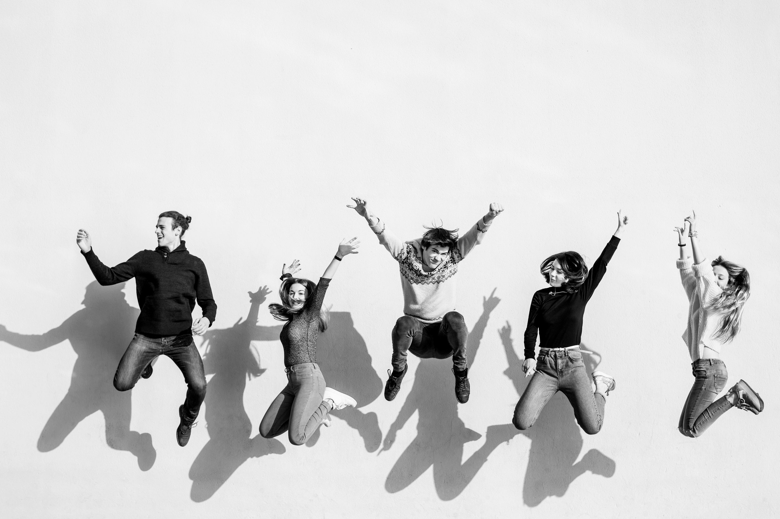 Employees jumping for joy