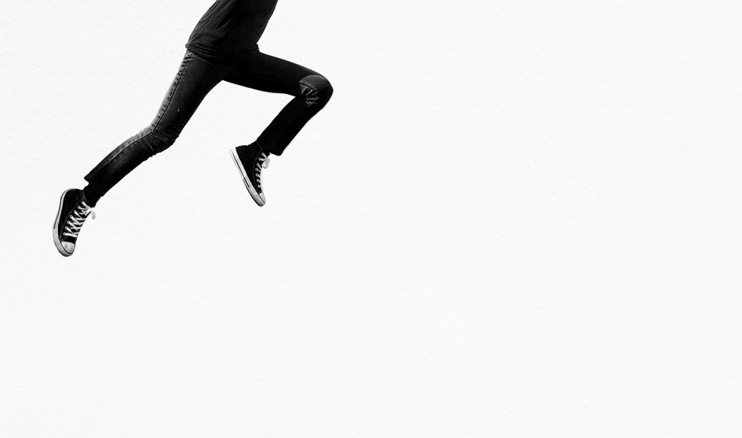 Man in jeans jumping