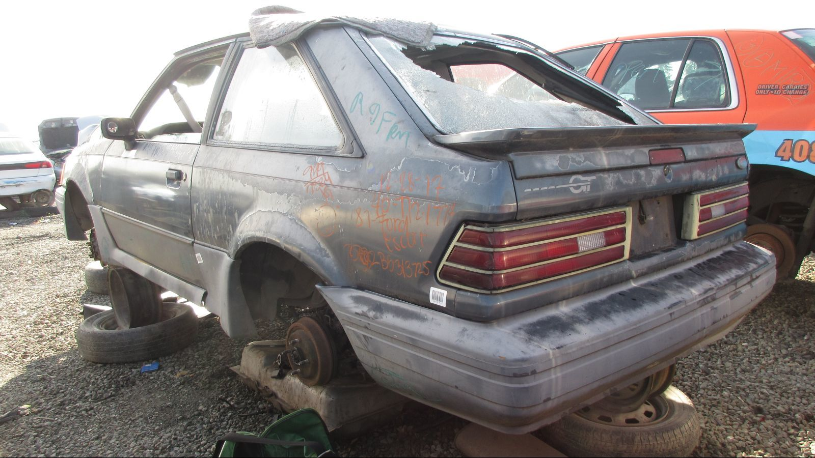 Junked 1987 Ford Escort Gt In California Wrecking Yard Photo