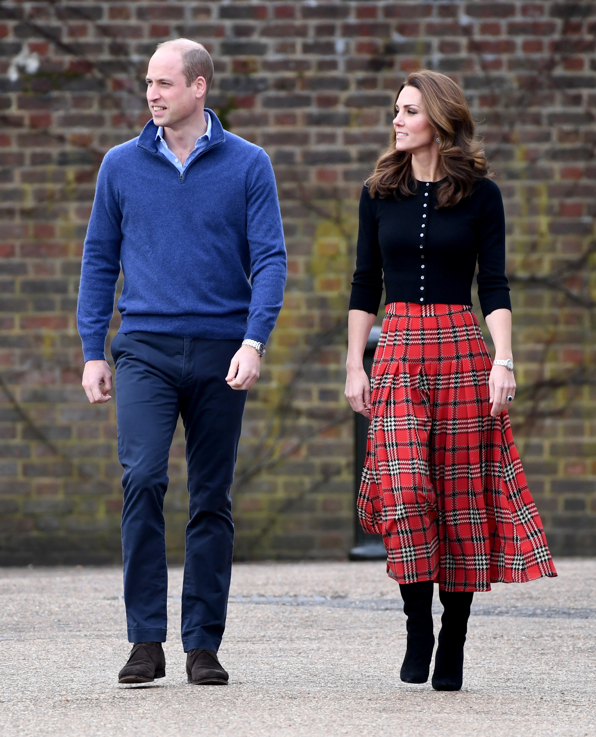 Duchess Kate is festive in red Emilia Wickstead to bring holiday cheer to military families