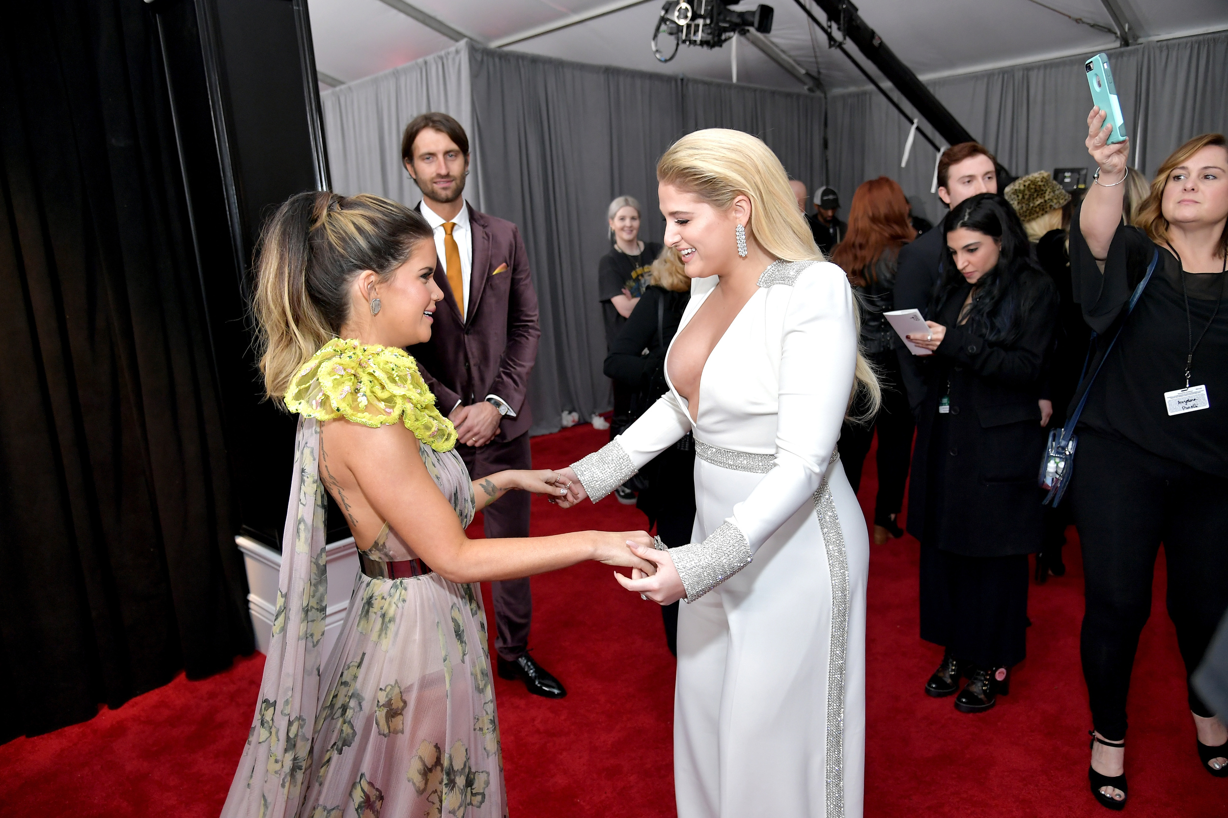 Truly, what is happening? Why would Meghan Trainor attempt a pantsuit, and why does Maren Morris s otherwise pretty dress have a giant neon yellow growth on the shoulder?