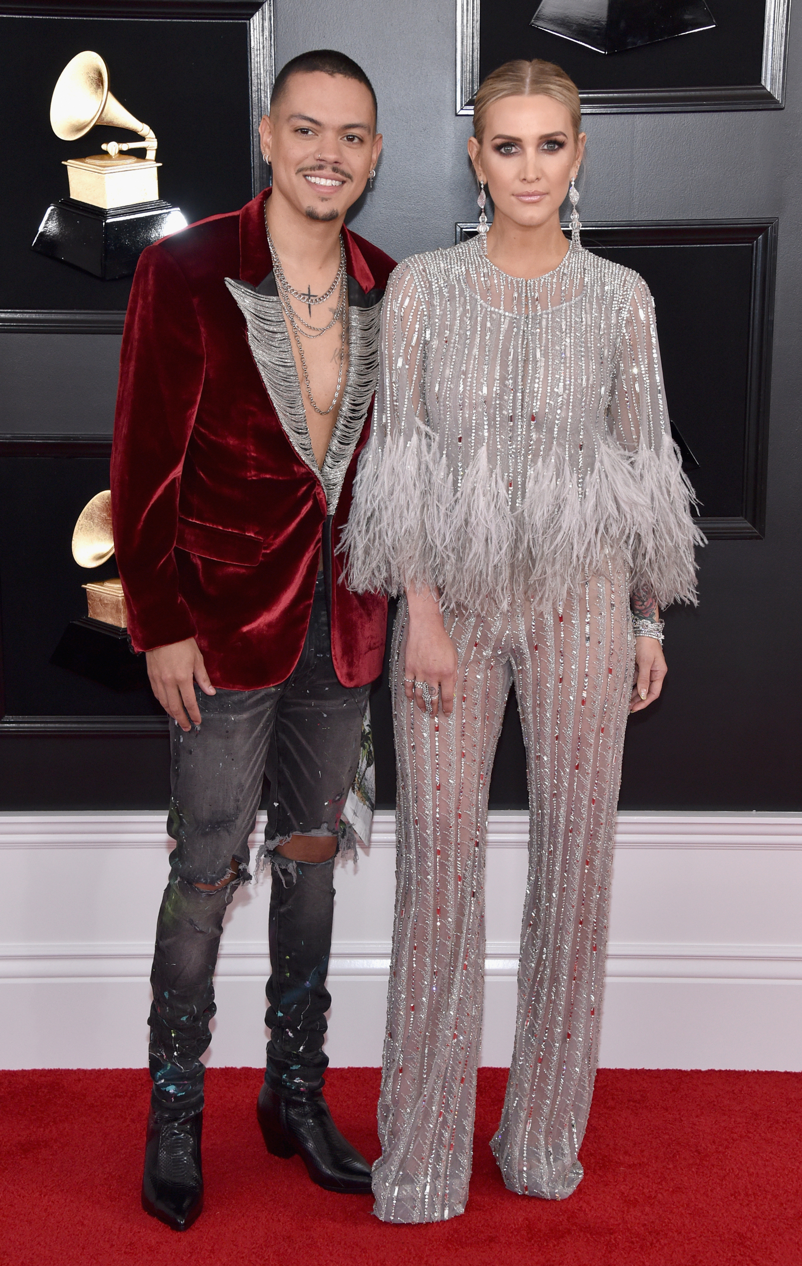 Ashlee Simpson s outfit looks like it started as a jumpsuit, added legs, and sprouted feathers. Evan Ross appears to have forgotten his shirt.