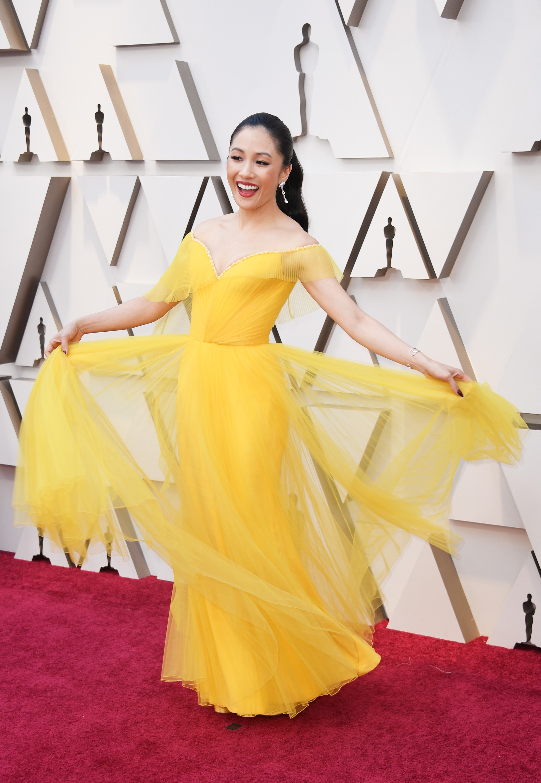 "The ""Crazy Rich Asians"" star is ultra-elegant in yellow tulle Versace."
