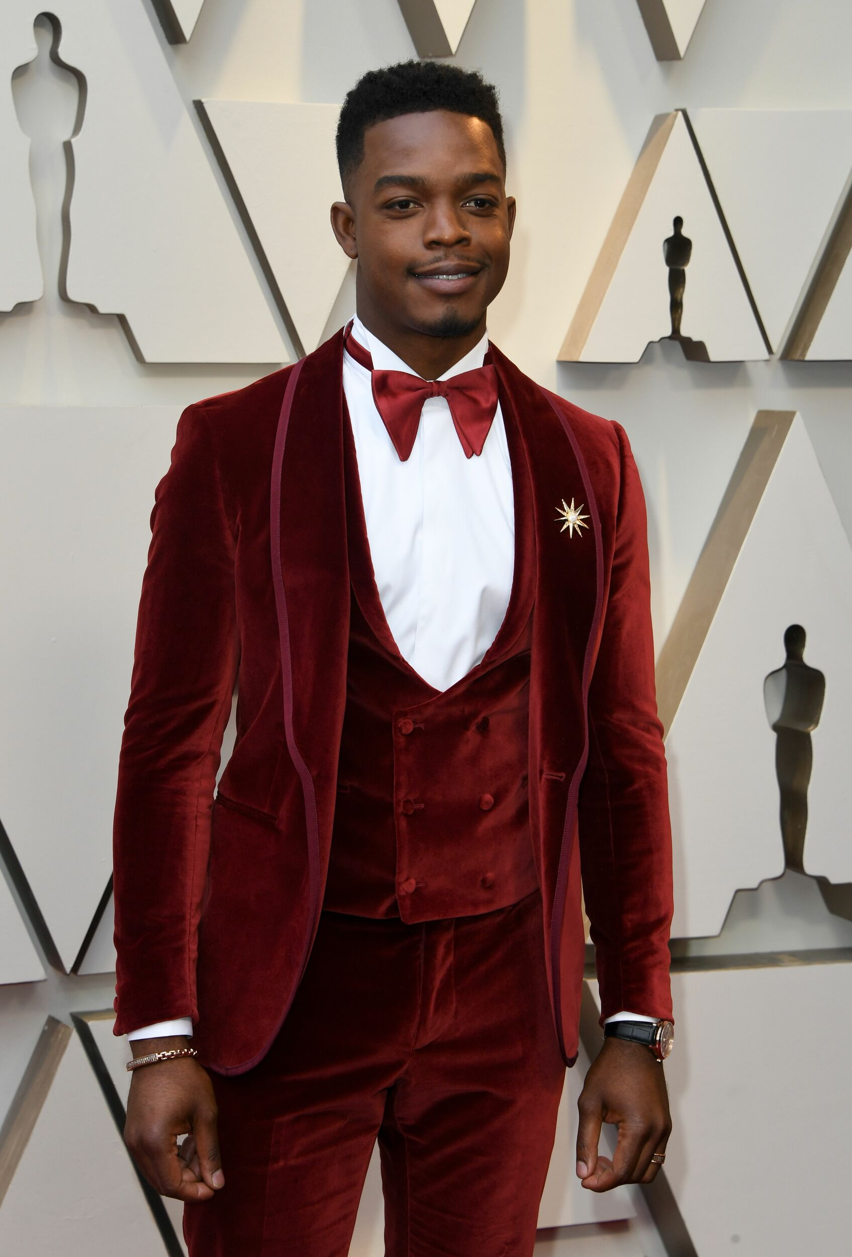 It s not easy to make menswear fun, but Toronto s own Stephan James looks extra-dapper in this custom burgundy velvet three-piece suit from Italian designer Etro.