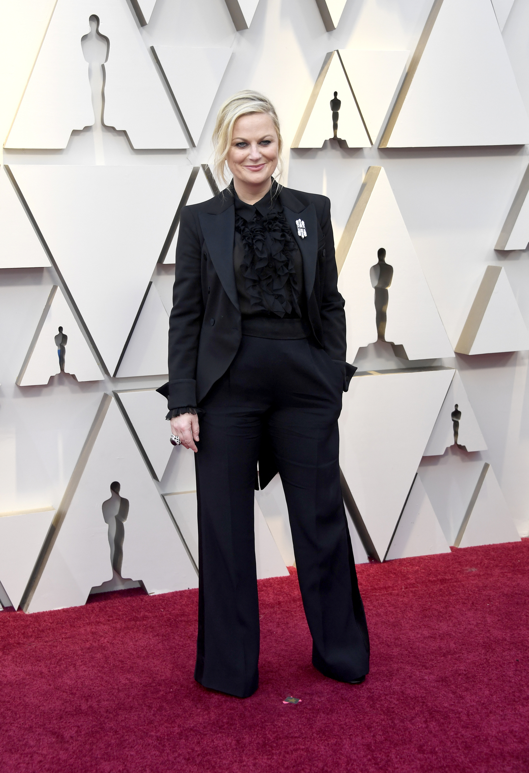 Honest question: Why have a host-free Oscars ceremony when Amy Poehler and this pantsuit are right here?