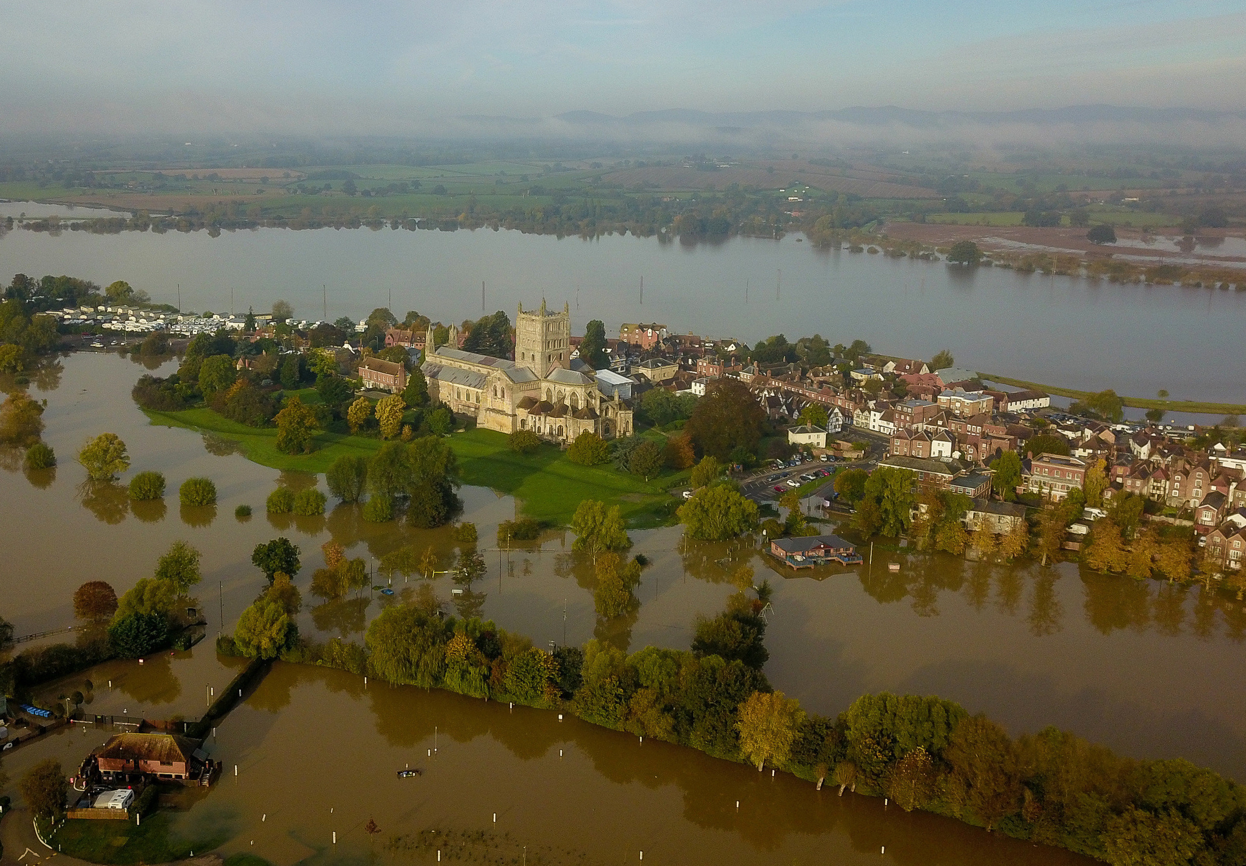 An entire town has been almost completely cut off by flood ...