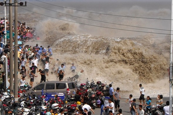 Tourists swept away as tidal bore crashes through safety wall in China