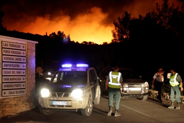 Over 1,200 people evacuated as fire threatens homes and holiday resorts in Ibiza
