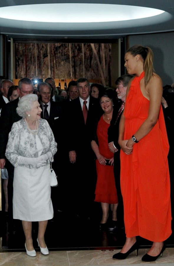 Little and large: Queen outsized by 7ft female basketball player on Australia trip