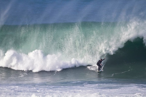 Surfer's paradise: Monster 50ft wave hits Fistral Beach in Cornwall