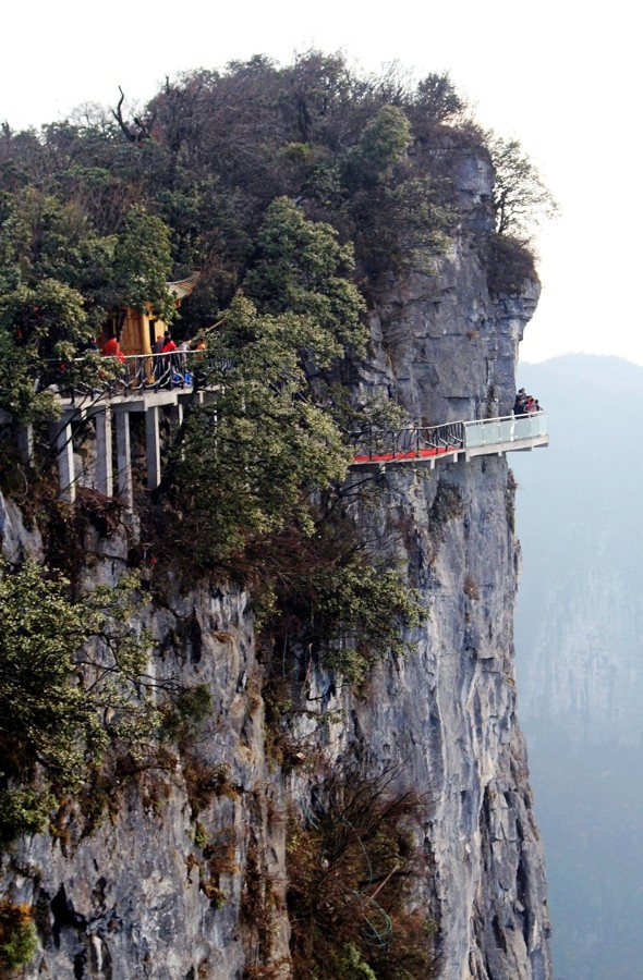 Walk of Faith! Glass pavement built round 1,430-metre high mountain for tourists in China