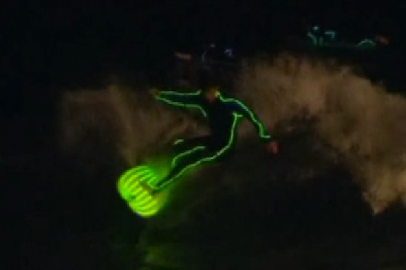 Video: Neon night surfers welcome the summer at Bondi Beach