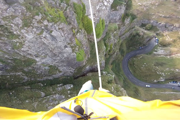 Man slacklines over the Cheddar Gorge