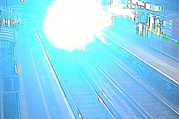 'Blinding explosion' as yobs push bike in front of commuter train