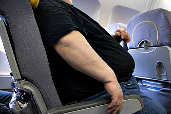 Half of British men think airlines should charge 'fat tax' on planes