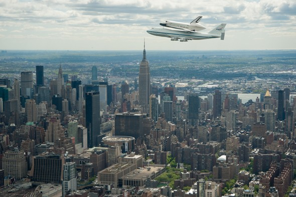 Space shuttle sails over New York's skyline in final flight