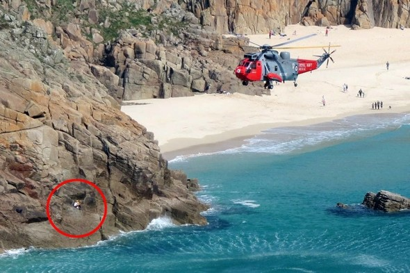 Helicopter rescues Cornwall holidaymaker as tide leaves her clinging to cliff