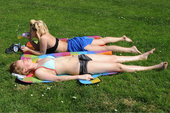 Brits go barmy for the hottest day of the year... but will it last?