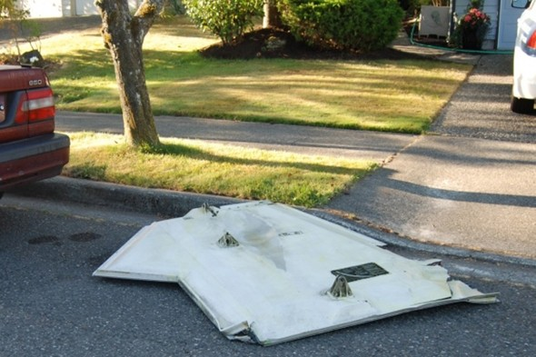 Missing something? Plane door falls from sky and lands on residential street