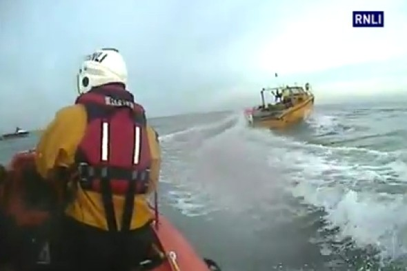 Video: Men rescued after boat hit by huge wave off Cornwall coast