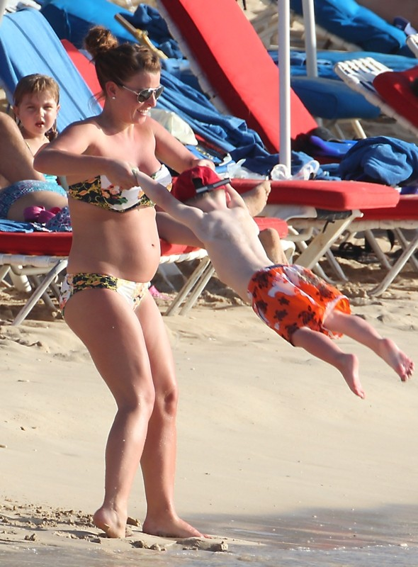 Coleen Rooney shows off baby bump on beach in Barbados