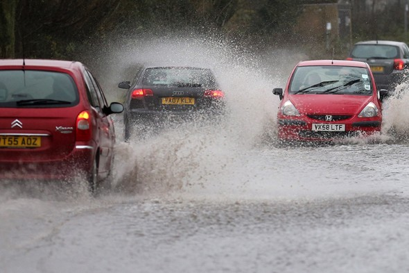 Back-to-work commuters stranded by floods as wet weather continues
