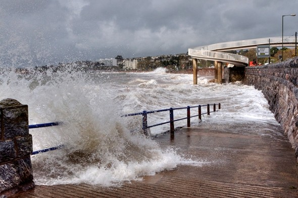 Torquay seafront closed and trains cancelled after flooding