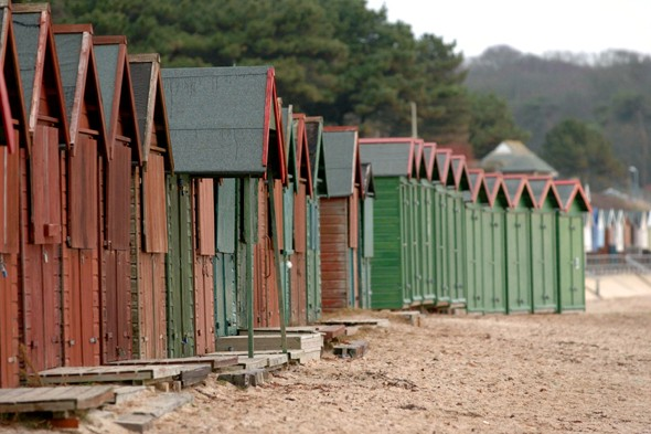 Grandfather camps out on Dorset beach for six days to secure beach hut
