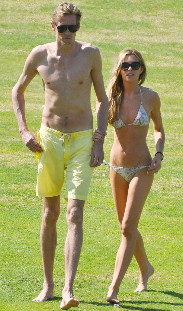 Abbey and Peter Crouch show off tiny beach bodies in Dubai