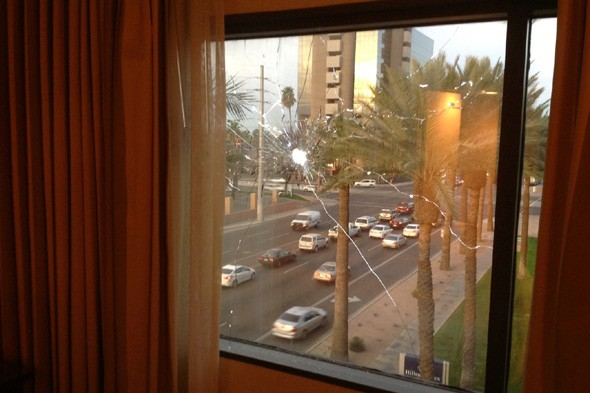 Hotel guest sleeps through loud noise and wakes up to find bullet holes in room