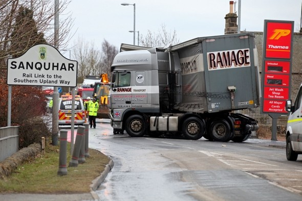 Sticky situation! Traffic chaos as lorry spills 19-ton load of glue
