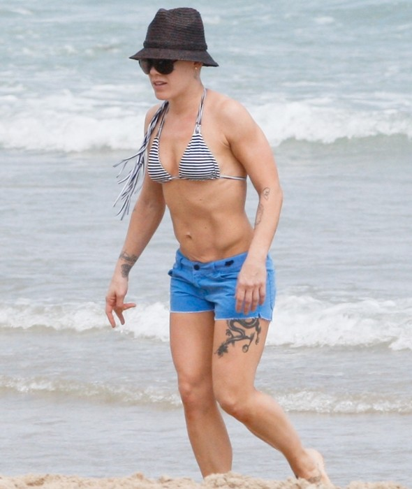 Pink shows off toned bikini body on family day at the beach