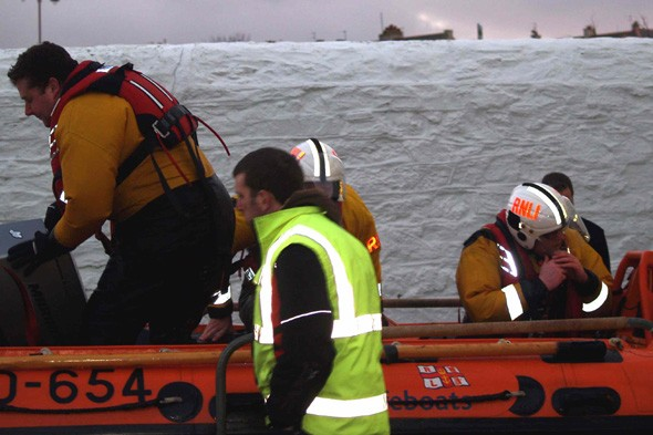 Cyclists rescued in Anglesey breakwater in 'atrocious' weather